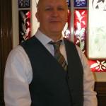 Minister Neil Evans